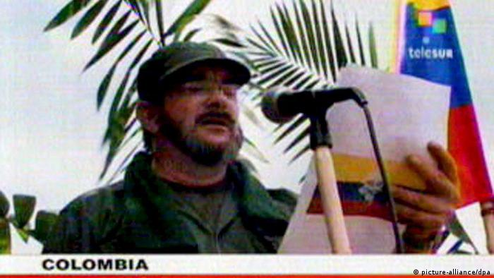 A TV video image captured off Venezuelan television network Telesur shows the Commander and member of the Central High Command Secretariat of the Revolutionary Armed Forces of Colombia - People's Army (FARC-EP)Rodrigo Londono-Echeverry a.k.a. 'Timoleon Jimenez' or 'Timochenko' who reads a press release some where in the Colombian jungle, 25 May 2008. The guerrilla commander announced and confirmed the dead of Pedro Antonio Marin, known as 'Manuel Marulanda Velez' a.k.a. 'Tirofijo' (Sureshot). EPA/TELESUR BEST QUALITY AVAILABLE EDITORIAL USE ONLY +++(c) dpa - Report+++