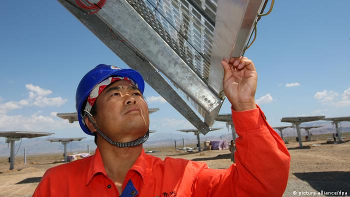 Chinese workers check and test solar panels