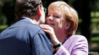 German Chancellor Angela Merkel (R) gestures next to Spain's Prime Minister Mariano Rajoy as they pose before their meeting at Moncloa Palace in Madrid, September 6, 2012. REUTERS/Andrea Comas (SPAIN - Tags: POLITICS BUSINESS)