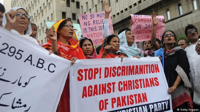 Activists of the National Christian party shout slogans in the support of a Christian girl who was accused of burning papers containing verses from the Koran, in Karachi on September 4, 2012(Photo: RIZWAN TABASSUM/AFP/GettyImages)