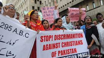 Activists of the National Christian party shout slogans in the support of a Christian girl who was accused of burning papers containing verses from the Koran, in Karachi on September 4, 2012 (Photo: RIZWAN TABASSUM/AFP/GettyImages)