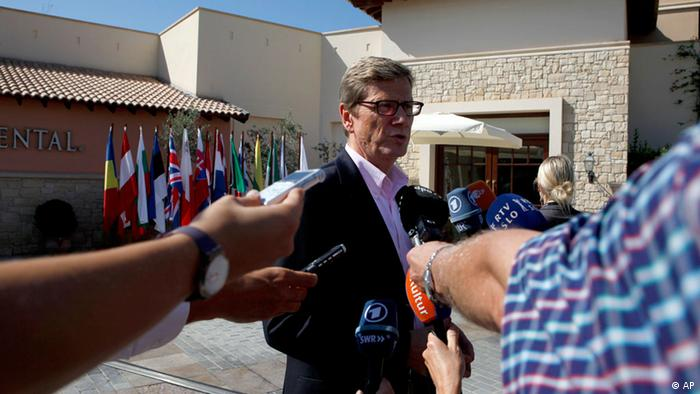 German Foreign Minister Guido Westerwelle speaks to the media as he arrives for an informal EU Foreign Affairs Ministers meeting in Kouklia, near of Paphos, Cyprus, Friday, Aug. 7, 2012. (Foto:Petros Karadjias/AP/dapd)