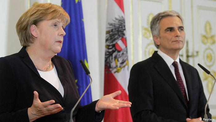 Austrian Chancellor Werner Faymann (R) and German Chancellor Angela Merkel brief the media during a news conference in the Chancellor's office in Vienna September 7, 2012. Merkel is on a one-day visit to Austria. REUTERS/Herwig Prammer (AUSTRIA - Tags: POLITICS)