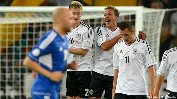 Germany's Mario Goetze (3-L) and Germany's Marco Reus (2-L) celebrate after scoring the goal the goal 1-0 during the Group C World Cup 2014 qualifying match between Germany and Faroe Islands at AWD Arena in Hanover, Germany, 07 September 2012. Photo: Marcus Brandt dpa/lni