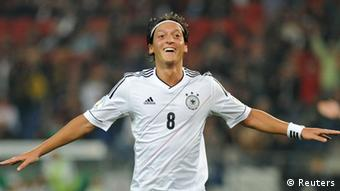 Germany's Mesut Oezil celebrates after scoring during the 2014 World Cup qualification soccer match against Faroe Islands in Hanover September 7, 2012.