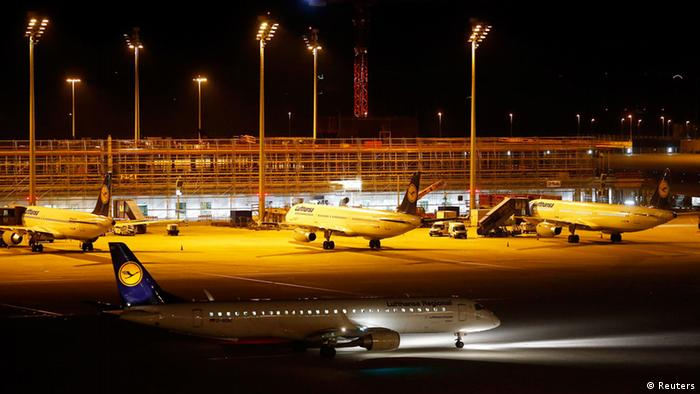 A Lufthansa plane taxies on the tarmac at an international airport at night. (Photo: Michael Dalder, REUTERS)