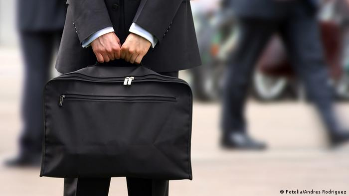 business man holding a briefcase (photo: Andres Rodriguez - Fotolia 2005)