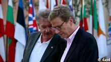 German Foreign Minister Guido Westerwelle, right, speaks with Luxembourg's Foreign Minister Jean Asselborn after an informal EU Foreign Affairs Ministers meeting in Kouklia, near Paphos, southwest of the island of Cyprus, Friday, Sept. 7, 2012. (AP Photo/Petros Karadjias)