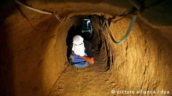 A file photograph dated 13 August 2008, shows a Palestinian worker digging a new tunnel between Gaza Strip and Egypt in Rafah refugee camp, southern Gaza Strip.