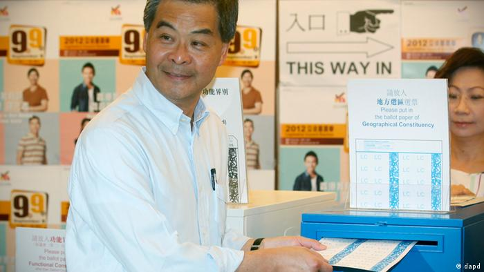 Hong Kong Chief Executive Leung Chun-ying, left and his wife Regina vote at a polling station for the legislative council election in Hong Kong, Sunday, Sept. 9, 2012. Hong Kong voters cast their ballots Sunday in legislative council elections that will see them choosing more than half the seats for the first time. Voters are selecting 40 representatives while 30 others are chosen by business and special interest groups. In previous votes, it was evenly split but 10 new seats have been added this time. (AP Photo/Kin Cheung)