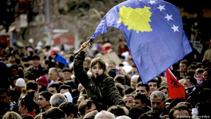 A Kosovo Albanian girl is holding a Kosovo flag as Kosovo Albanians take to the streets to mark the first anniversary of their declaration of independence from Serbia in Pristina, Kosovo on 17 February 2009. Kosovo declared independence on 17 February 2008. Recognised as independent by more than 50 countries including the United States and most EU states, but not recognised by others including Russia, China and Serbia, Kosovo's political stability is precarious. EPA/ERMAL META +++(c) dpa - Report+++