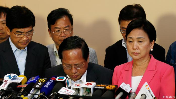 Albert Ho Chun-yan reacts as he announces his resignation from Chairman of the Democratic Party, in between Vice Chairman Emily Lau and member Sin Chung-ka, at the central ballot counting centre of the Legislative Council election in Hong Kong September 10, 2012.Political allies of Hong Kong's new Beijing-backed leader performed solidly in city-wide legislative council elections despite recent controversies over contentious China-linked policies, potentially easing pressure on his administration.REUTERS/Tyrone Siu (CHINA - Tags: POLITICS ELECTIONS)