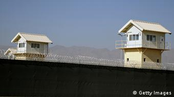 Watchtowers are seen along the perimeter of the Bagram prison, north of Kabul, (Photo: MASSOUD HOSSAINI/AFP/Getty Images)