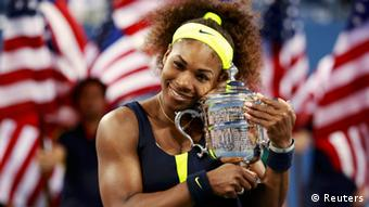Serena Williams of the U.S. poses with her trophy after defeating Victoria Azarenka of Belarus in their women's singles finals match at the U.S. Open tennis tournament in New York September 9, 2012. REUTERS/Kevin Lamarque (UNITED STATES - Tags: SPORT TENNIS TPX IMAGES OF THE DAY)