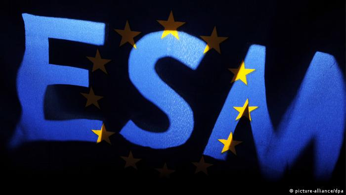 An EU flag shines through the cutout letters ESM Photo: Franziska Kraufmann dpa/lsw