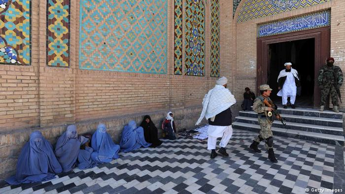 Afghan women beggers sit on the ground in front of Jame mosque during Eid Al-Adha in Herat Photo: Aref Karimi/AFP/Getty Images