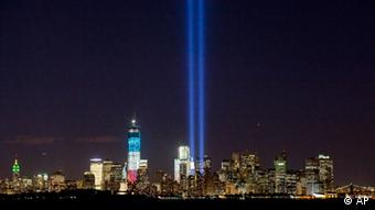The Tribute in Light shines above the World Trade Center and the Statue of Liberty, left of center, Monday, Sept. 10, 2012 as seen from Bayonne, N.J. Photo: AP Photo/Mark Lennihan)