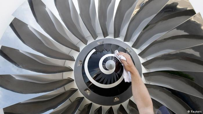 A man cleans a piece of an aircraft engine before the ILA Berlin Air Show in Selchow near Schoenefeld south of Berlin, September 10, 2012. (Photo: Reuters)