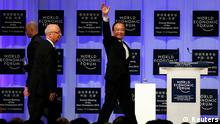 Chinese Premier Wen Jiabao (R) waves as he arrives with Klaus Schwab (2nd R), founder and executive chairman of the World Economic Forum (WEF), during a session of the WEF in the Chinese port city of Tianjin September 11, 2012. REUTERS/David Gray (CHINA - Tags: BUSINESS POLITICS)