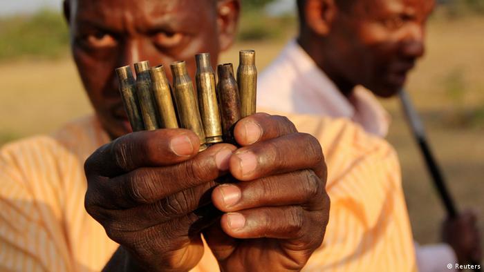 A man displays used bullet cartridges (photo: REUTERS/Charles Makunda