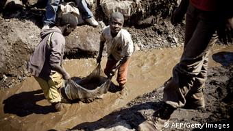 Children washing copper at an open-air mine in the rich mining province of Katanga. (Photo: Gwenn Dubourthoumieu/AFP/Getty Images)