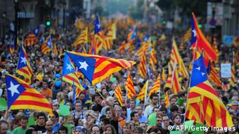 Supporters of independence for Catalonia demonstrate on September 11, 2012 in Barcelona to mark the Spanish region's official day, amid growing protests over Spain's financial crisis which has driven it to seek aid from the central government. Catalonia's leader warned of a 'freedom' bid for the region as tens of thousands of people poured into Barcelona demanding a split from Spain and control of their own economy. AFP PHOTO / LLUIS GENE (Photo credit should read LLUIS GENE/AFP/GettyImages)