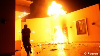 The US Consulate in Benghazi is seen in flames (picture: Reuters)