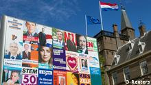 Campaign posters are seen in front of the Dutch Parliament in The Hague September 11, 2012. Voting begins for the Dutch general election on Wednesday. REUTERS/Michael Kooren (NETHERLANDS - Tags: POLITICS ELECTIONS)
