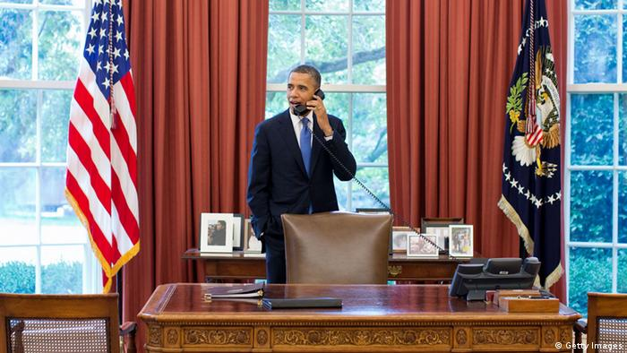 In this handout provided by the White House, U.S. President Barack Obama talks on the phone with Solicitor General Donald Verrilli in the Oval Office, after learning of the Supreme Court's ruling on the 'Patient Protection and Affordable Care Act' on June 28, 2012 in Washington, D.C. With Chief Justice John Roberts voting with the liberal members of the high court, the Supreme Court ruled 5-4 that the Obama Administration's signature legislative accomplishment is constitutional.