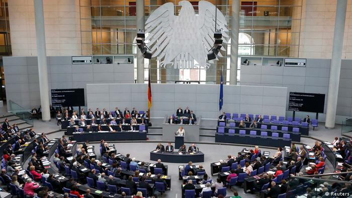 German Chancellor Angela Merkel (C) addresses a session of the Bundestag, German lower house of parliament, at the Reichstag in Berlin September 12, 2012. Germany's Constitutional Court gave a green light on Wednesday for the country to ratify the euro zone's new rescue fund and budget pact but gave parliament veto powers over any future increases in the size of the fund.The eagerly anticipated verdict by the court in Karlsruhe, southern Germany, boosted global stocks and the euro currency as investors breathed a sigh of relief that the euro zone's rescue fund could take effect after months of delay. REUTERS/Fabrizio Bensch (GERMANY - Tags: BUSINESS POLITICS)