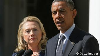 US President Barack Obama next to Secretary of State Hillary Clinton during a statement about the death of U.S. ambassador to Libya Photo by Chip Somodevilla/Getty Images