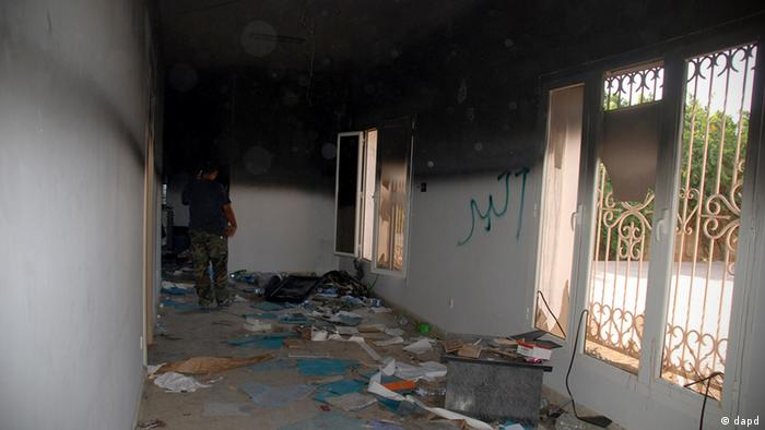 A man walks through a room in the gutted US consulate in Benghazi (Photo: (AP/Ibrahim Alaguri)