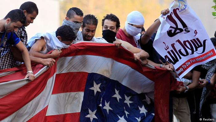 Protesters destroy an American flag pulled down from the U.S. embassy in Cairo September 11, 2012. Copyight: REUTERS/ Mohamed Abd El Ghany