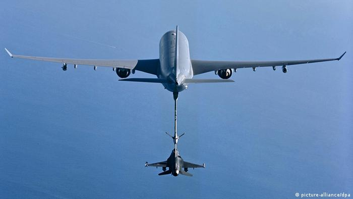 An Airbus A330 MRTT tanker refueling one F-16 fighter