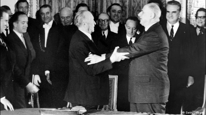 PARIS, FRANCE: French President General Charles de Gaulle (R) and German Chancellor Dr Konrad Adenauer (L) hug each other 22 January 1963 at the ElysTe Palace in Paris after signing the French-German cooperation treaty. (Photo credit should read AFP/Getty Images)