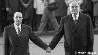 Verdun, FRANCE: (FILES) - Photo dated 22 September 1984 o a battlefield near Verdun, shows French President Francois Mitterrand (l) holding hands with German Chancellor Helmut Kohl, commemorating the deaths of French and German trops during two world wars. AFP PHOTO MARCEL MOCHET (Photo credit should read -/AFP/Getty Images)