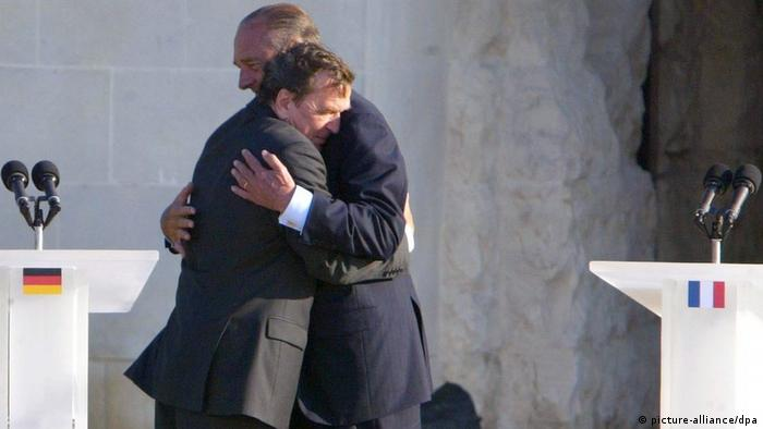 Gerhard Schröder hugging Jacques Chirac in Cannes