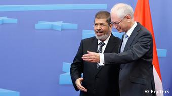 European Council President Herman Van Rompuy welcoming Egypt's President Morsi Copyright: REUTERS/Francois Lenoir