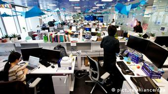 Staff members are seen working at the office of Google in Shanghai, China (Picture: source unknown)