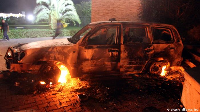 A photo made available on 12 September 2012, shows a vehicle set on fire at the US consulate, in Benghazi, Libya, 11 September 2012. EPA/MUSTAFA EL-SHRIDI