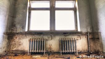 A room with old radiators in bad condition