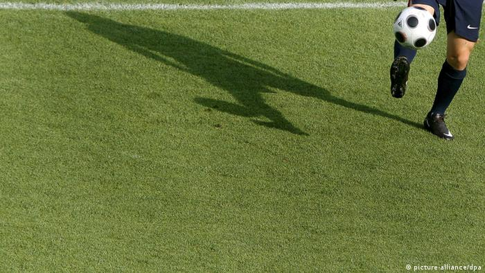 The shadow of Russian national soccer team forward Andrei Arshavin is seen during his team's training session at the Ernst Happel stadium in Vienna, Austria, 25 June 2008. Russia will face Spain in their EURO 2008 semi final match on 26 June in Vienna. EPA/KERIM OKTEN +please note UEFA restrictions particulary in regard to slide shows and 'No Mobile Services'+ +++(c) dpa - Report+++