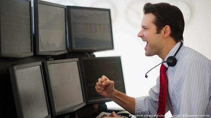 Stockbroker looking at monitors