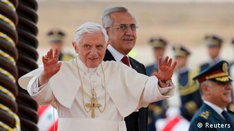 Pope Benedict XVI waves from the podium next to Lebanon's President Michel Suleiman upon his arrival at Beirut's airport September 14, 2012. Pope Benedict appealed for a stop to arms imports to Syria on Friday, saying it would help end the civil war there, and said the Arab Spring was a positive cry for freedom as long as it included religious tolerance. REUTERS/Stefano Rellandini (LEBANON - Tags: RELIGION POLITICS)