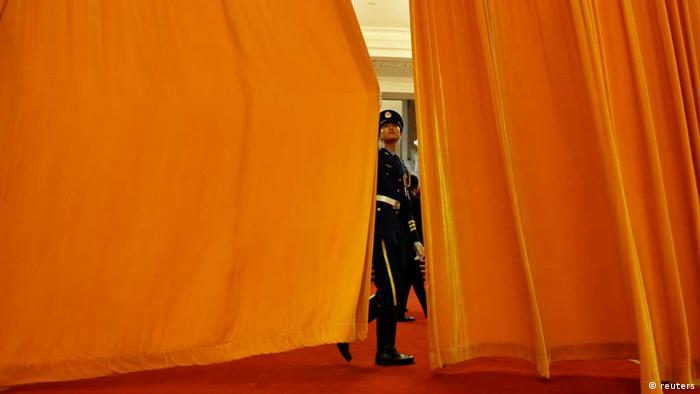 Source News Feed: EMEA Picture Service ,Germany Picture Service A soldier from an honour guard closes a curtain ahead of an official welcoming ceremony for German Chancellor Angela Merkel at the Great Hall of the People in Beijing August 30, 2012. Germany's Angela Merkel makes her second trip to China in half a year this week, hoping to strengthen booming trade ties and obtain assurances from Beijing that it will support the fragile euro zone by buying the bonds of its stricken southern members. REUTERS/Jason Lee (CHINA - Tags: POLITICS BUSINESS) /eingest. sc