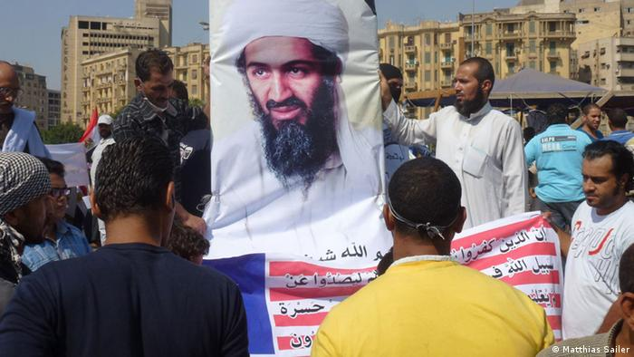 Demonstrators in Cairo with a poster of Osama bin Laden