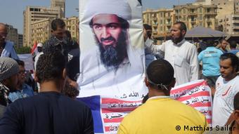 Radical demonstrators in Cairo hold aloft a portrait of Osama bin Laden