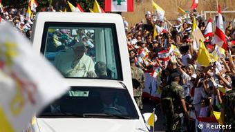 Pope Benedict XVI greets faithful from his Pope Mobile upon arrival at the Baabda Presidential Palace near Beirut September 15, 2012. REUTERS/Mohamed Azakir (LEBANON - Tags: POLITICS RELIGION)