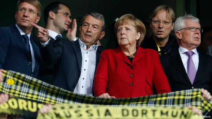 Chancellery Minister Ronald Pofalla, President of the German soccer federation (DFB) Wolfgang Niersbach, German Chancellor Angela Merkel and Borussia Dortmund President Reinhard Rauball (L-R) watch the German first division Bundesliga soccer match between Borussia Dortmund against Bayer Leverkusen in Dortmund September 15, 2012. REUTERS/Ina Fassbender