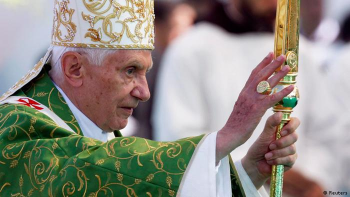 Pope Benedict XVI offers blessings as he arrives to conduct an open-air mass service at Beirut City Center Waterfront September 16, 2012. REUTERS/ Stefano Rellandini (LEBANON - Tags: RELIGION)